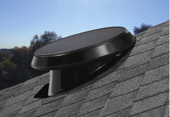 Roof mounted ventilation fan with a pitch to improve sun exposure.